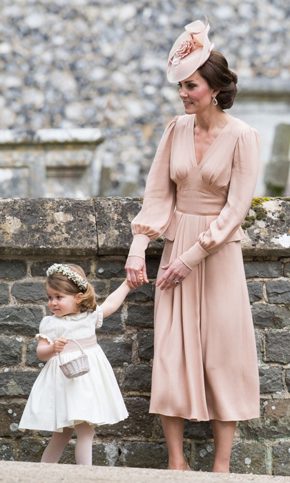For her younger sister's wedding, Kate wore Alexander McQueen just like she did for her own nuptials in 2011. This time, she wore a silk blush dress that was Elizabethan-inspired.