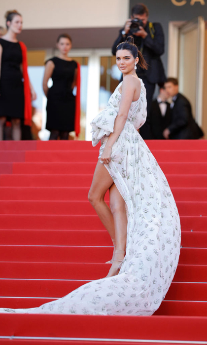 Our hearts beat fast for this Giambatista Valli mini with an extra long train. Kendall Jenner paired the patterned dress with Chopard jewels for the <i>120 Beats Per Minute</i> premiere.