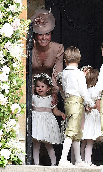 For her sister Pippa's wedding on May 20, 2017, the Duchess of Cambridge had a very important role of keeping the pageboys and flower girls including George and Charlotte in line. Kate at one point was seen showing Charlotte what to do prior to walking down the aisle.