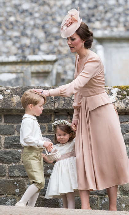 As guests made their way out of the ceremony, Kate held on to two-year-old Charlotte's hand as she patted George's head. Ahead of the wedding, Kate told guests at their garden party that she really hoped her children would behave.