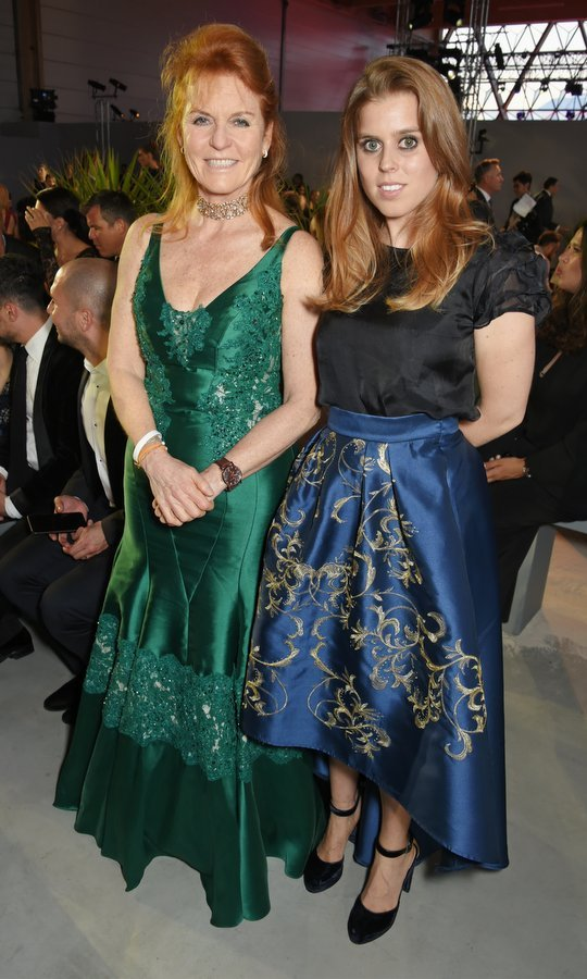 Princess Beatrice and her mother, Sarah, Duchess of York, were twinning in jewel-toned silk outfits at the the Fashion for Relief charity fundraiser during the 70th Annual Cannes Film Festival at Aeroport Cannes Mandelieu.