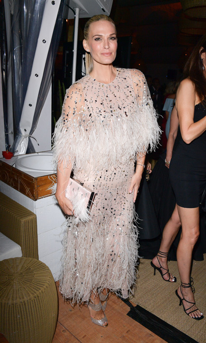 Molly Sims wore a feathered Monique Lhuillier dress to the Hollywood Foreign Press Association's philanthropic celebration honoring the International Rescue Committee at Nikki Beach. 
