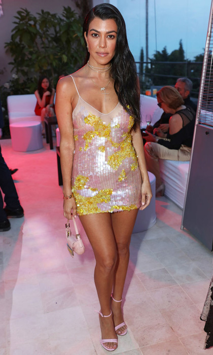 Kourtney Kardashian, who is in Cannes with new beau Younes Bendijma, wore a light pink sequined mini at the <i>Wonders of the Sea</i> dinner at Villa Golden Gate.