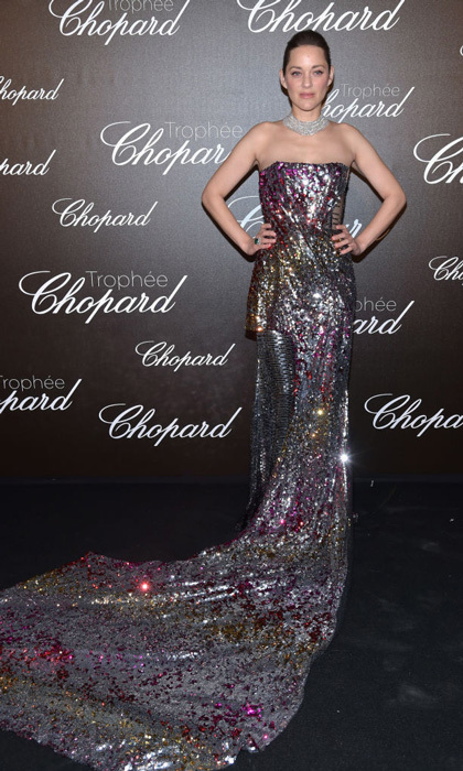 Marion Cotillard wore a Michael Halpern gown to the Chopard Trophy carpet at Hotel Martinez. The gown, which was specifically made for the actress, had multi-colored sequins that looked different depending on the angle.