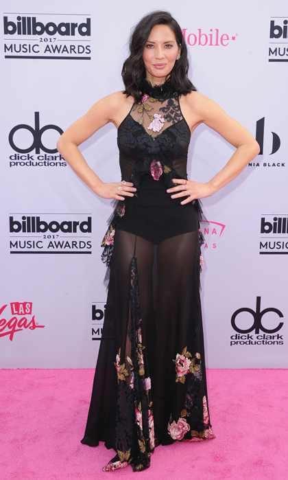Olivia Munn wore a black and floral sheer dress to the Billboard Music Awards in Las Vegas.