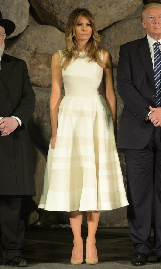 First lady Melania Trump wore a cream sleeveless Roksanda dress with A-line skirt to join her husband President Trump to tour the Yad Vashem Holocaust museum in Jerusalem on May 23, 2017.