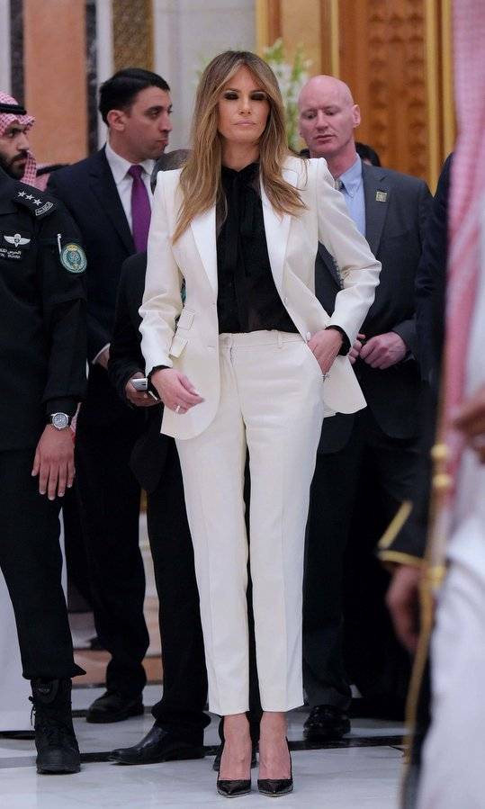 The First Lady loves her neutrals! Here she is wearing a white pantsuit and black blouse ahead of the Arab Islamic American Summit at the King Abdulaziz Conference Center in Riyadh on May 21, 2017.