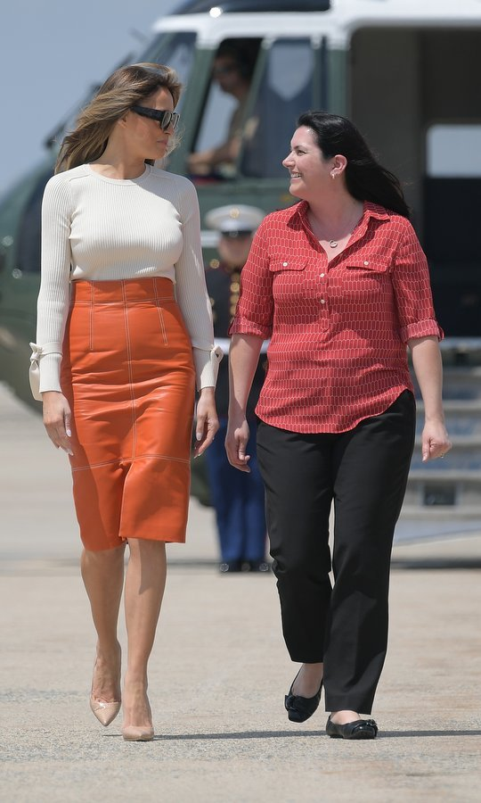 Melania wore a Kate Middleton fave – nude pumps – along with her Herve Pierre orange leather shirt and bow-bedecked pullover as she boarded Air Force One to depart from Andrews Air Force Base in Maryland on May 19, 2017. The First Lady was setting off for her first foreign tour with husband Donald Trump.