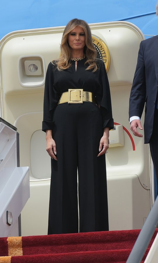Oversized gold accessories added some of Melania's signature opulent glam to her little black Stella McCartney jumpsuit as she arrived at King Khalid International Airport in Riyadh on May 20, 2017.