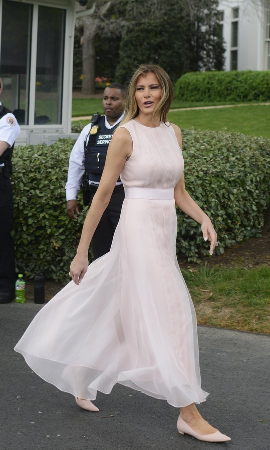 Melania wore a breezy pink, tea-length dress by Hervé Pierre as she hosted her first Easter Egg Roll at the White House in April 2017.
