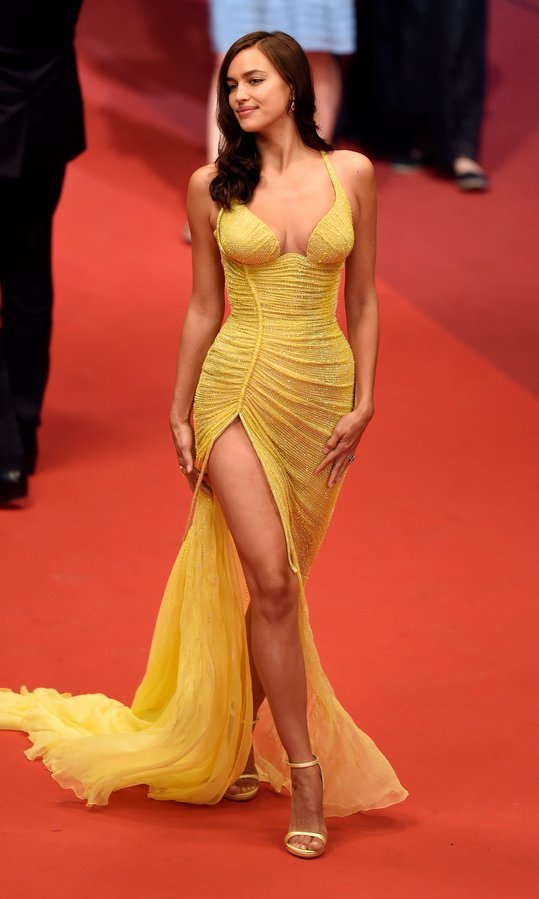 Supermodel mama Irina Shayk, who welcomed a little girl with partner Bradley Cooper in March 2017, made a confident return to the red carpet on May 23. The Pronovias and Victoria's Secret beauty wore a yellow floor-length Atelier Versace gown to the screening of <I>Hikari (Radiance)</I> during the 70th annual Cannes Film Festival at Palais des Festivals.