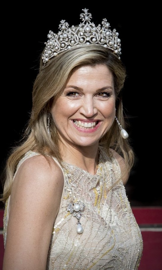 Which shines brighter – Queen Maxima of the Netherlands' spectacular tiara or her famous contagious grin? The Dutch royal was all smiles at at a gala dinner for the Corps Diplomatic at the Royal Palace in Amsterdam on May 23. 
