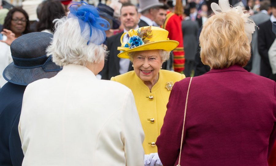 Pleased to meet you, ma'am... Queen Elizabeth seemed to enjoy her time speaking with guests during a garden party at Buckingham Palace on May 23.