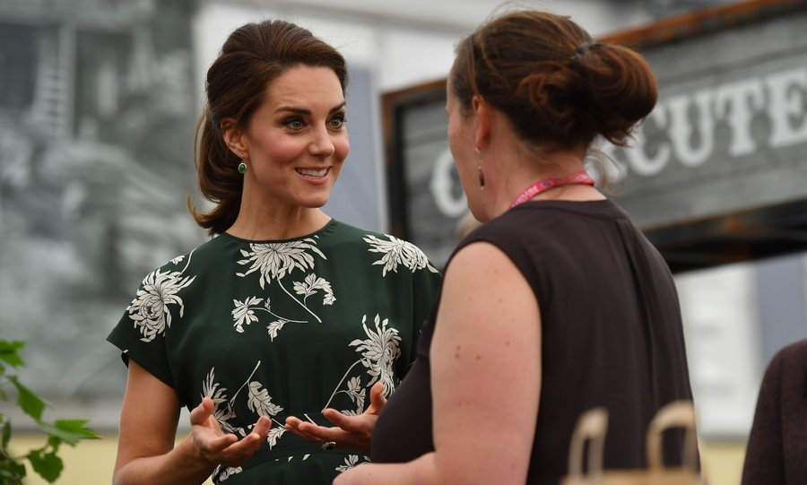 Avid gardener Catherine, Duchess of Cambridge chatted with an exhibitor as she visited the RHS Chelsea Flower Show press day at Royal Hospital Chelsea on May 22 in London.