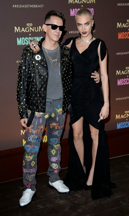 Cara Delevingne showed off her long legs in a high-low dress by Moschino next to Jeremy Scott at the Magnum party.