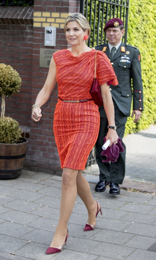 Queen Maxima of the Netherlands showed off her famed colorful style as she attended the Wijzer Symposium in Amsterdam.
