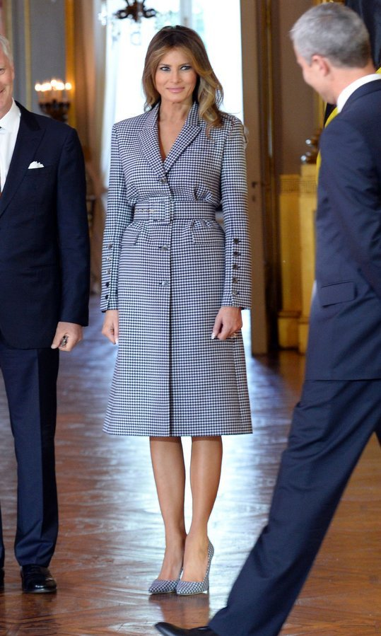The First Lady wore a checkered Michael Kors coat dress and matching pumps as she met with King Philippe and Queen Mathilde of Belgium at the Royal Palace in Brussels on May 25.