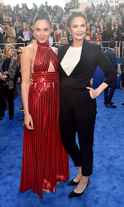 It's a Wonder Women meet-up! Gal Gadot, who plays the iconic role in the new film, and Lynda Carter, star of the 1970s TV series, joined forces on the blue carpet at the premiere of Warner Bros. Pictures' <I>Wonder Woman</I> at the Pantages Theatre in Hollywood, California. Gal is wearing a sparkling red gown by Givenchy.