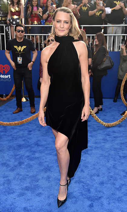 <I>Wonder Woman</I> co-star Robin Wright wore a velvet Saint Laurent LBD to the film's premiere in Hollywood. 