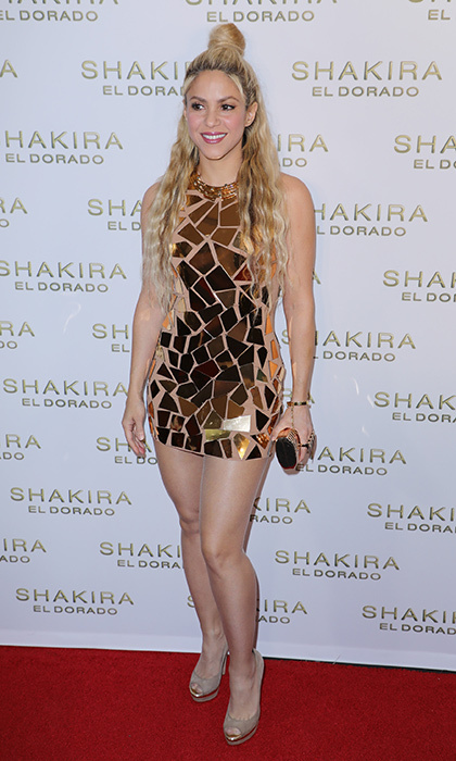 Shakira rocked a top knot and a gold minidress for the launch of her El Dorado album release party at  The Temple House in Miami.