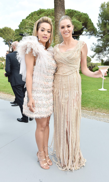 Kate Upton sipped the Belvedere amfAR martini as she chatted with Rita Ora during the foundation's gala in Cannes. The event raised millions for AIDS research with auction items and donations.