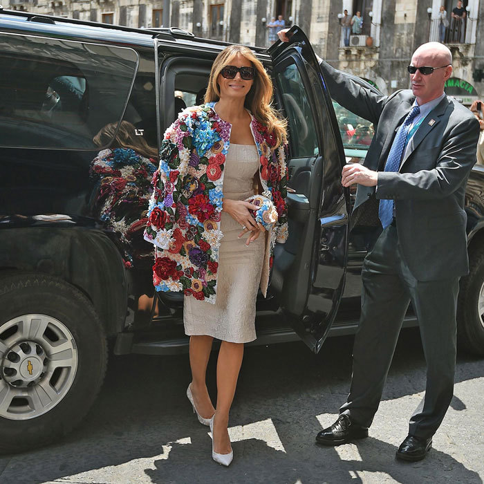 President Donald Trump's wife made a floral statement stepping out in a $51,500 jacket by Dolce & Gabbana in Sicily. Melania, 47, exuded glamour as she arrived to the Chierici Palace City Hall of Catania on the sidelines of a G7 summit of the Heads of State and of Government in Taormina wearing the piece that features 3D floral details over a sleeveless creme brocade sheath dress, which she paired with a matching Dolce & Gabbana floral pouchette clutch, pumps and shades.