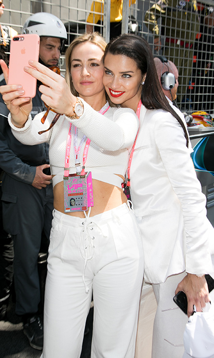 May 28: Spanish race car driver Carmen Jorda snapped a selfie with Brazilian model Adriana Lima during the Monaco Formula One Grand Prix at Circuit de Monaco.