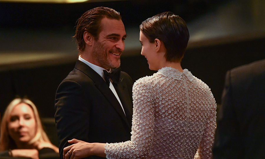 Making their public debut as a couple, Rooney Mara and Joaquin Phoenix had shared an embrace as he won the best actor prize.