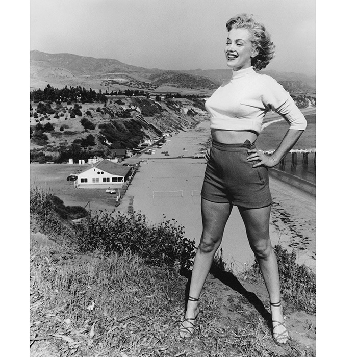 A crop top, sandals and high-waisted shorts for a 1953 photo shoot on the California coast.