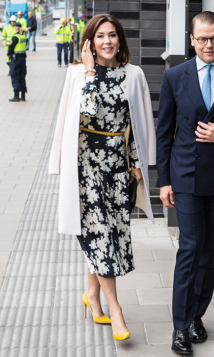 Crown Princess Mary of Denmark added a dose of sunshine – yellow pumps and belt – to her monochrome print silk dress while in Stockholm.