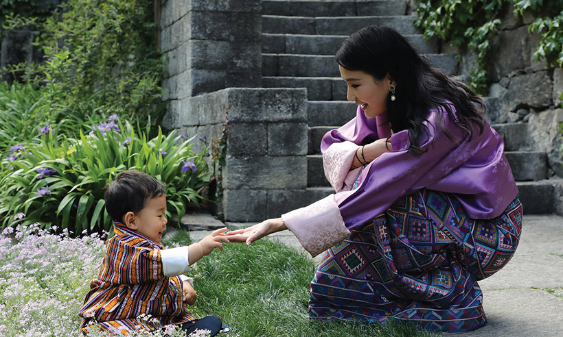 To celebrate his mom's 27th birthday on June 4, the one-year-old posed in a garden with Her Majesty Queen Jetsun Pema. The palace released the photo for their June calendar and it was taken in the Lingkana Palace gardens. 