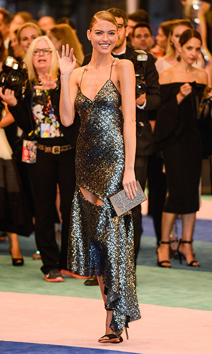 Martha Hunt arrived wearing a spaghetti-strap dress by Milly.