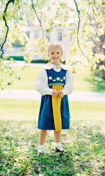 June 2017: To mark Sweden's National Day, Princess Estelle smiled big in her traditional blue, yellow and white folk dress, while sweeping her golden locks up into braided pigtails. 
