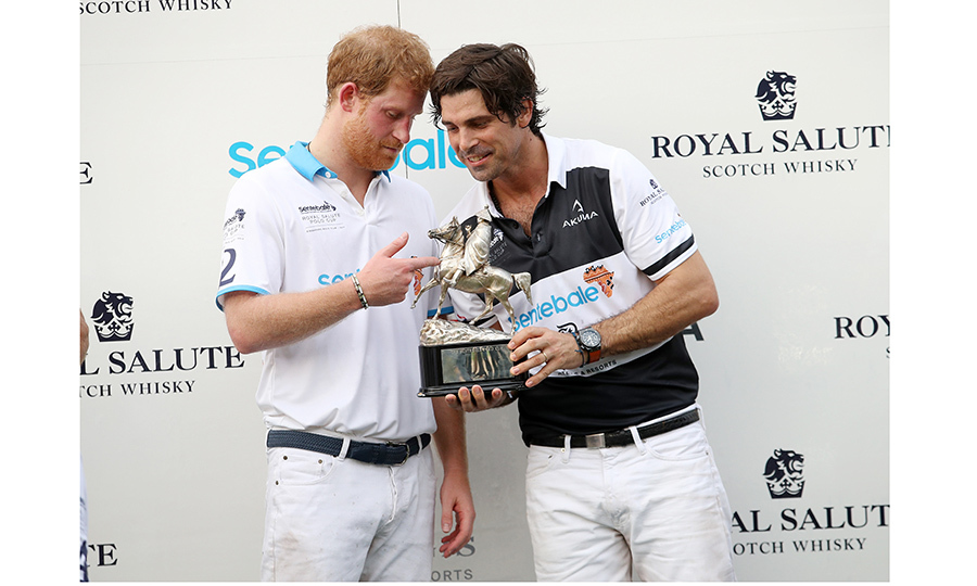 Good pals Prince Harry and Argentine polo champion Nacho Figueras bonded over the trophy at the Sentebale Royal Salute Polo Cup – a fundraiser for Harry's charity – in Singapore. 