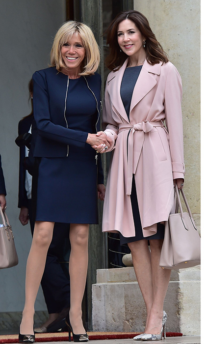 Crown Princess Mary of Denmark shook hands with French First Lady Brigitte Macron after a meeting on climate change on June 6 at the Elysee Palace in Paris.