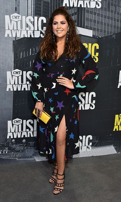 June 7: Hillary Scott of Lady Antebellum had us seeing stars at the 2017 CMT Music Awards in this Rixo London dress and Swarovski earrings. 