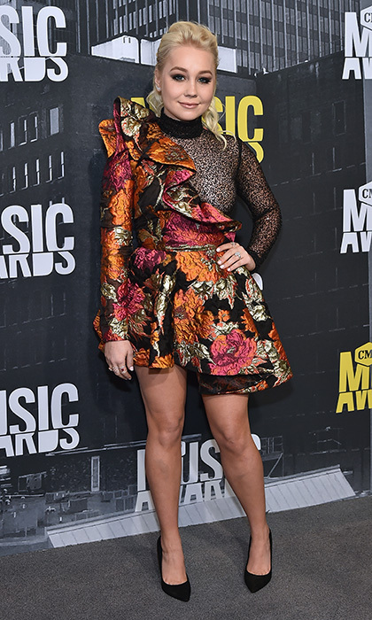 June 7: Singer-songwriter RaeLynn kept things short and sweet in a floral one-shouldered mini at the 2017 CMT Music Awards.