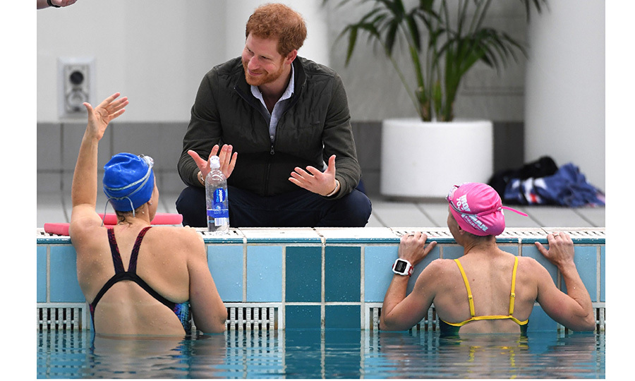 Prince Harry stayed dry in Sydney on June 8 as he chatted with former soldiers during swim training. The royal was helping mark 100 days until the next Invictus Games.