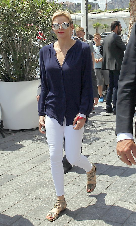 Mirrored shades and gladiator sandals are warm weather staples for a lot of us – including Princess Charlene! The Monaco royal wore this look, along with white skinny jeans, for the Riviera Water Bike Challenge on June 4 in Monte-Carlo.