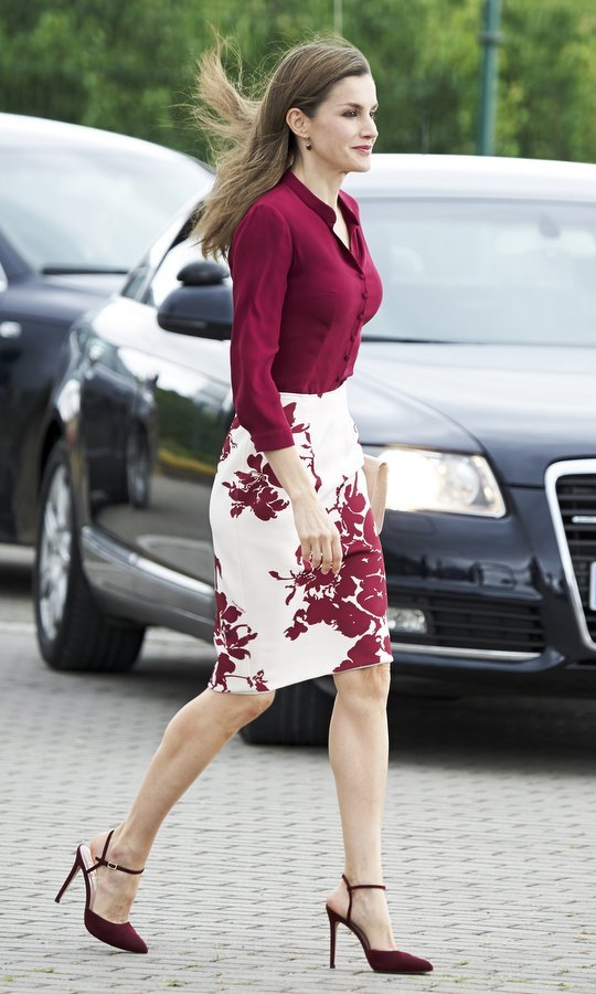 Burgundy is one of Queen Letizia's signature colors – and here's the Spanish royal stepping out in the rich shade during a visit to San Adrian, Spain.