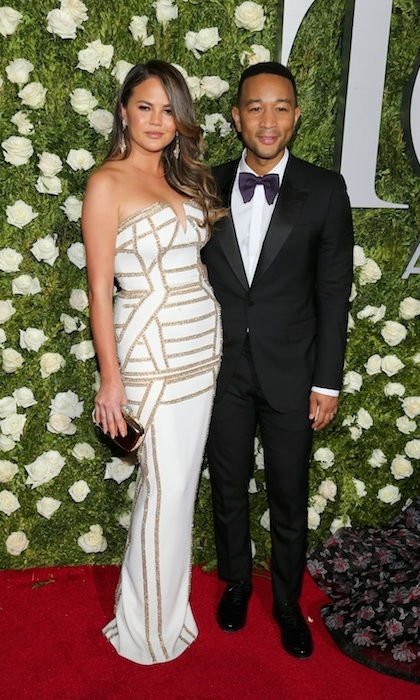 June 11: Chrissy Teigen won major fashion points in a strapless column dress by Pamella Roland. Her husband John Legend looked equally stunning in a black tux.