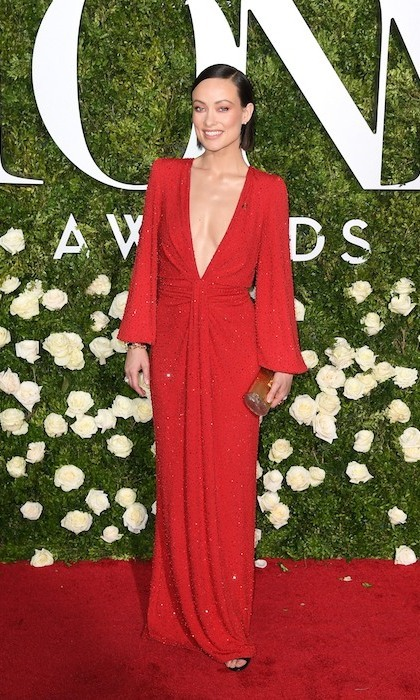 June 11: Leading the fashion parade at the Tonys, held at NYC's Radio City Music Hall, was Olivia Wilde in vibrant red Michael Kors Collection.