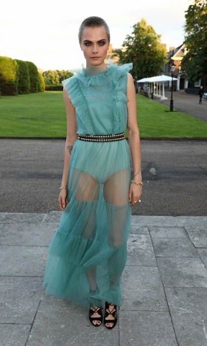 June 12: Cara Delevingne wowed wearing a blue ruffled Burberry gown that featured a sheer skirt to the Save the Elephants Gala held at Kensington Palace's The Orangery. 