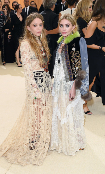 The designers both wore lace bohemian-styled gowns to the Met Gala in May 2017.