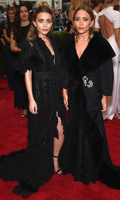 Black on black on black. Not only did the former actresses match in their black gowns with similar v-necks, they also parted their hair down the middle during the 2015 Met Gala.