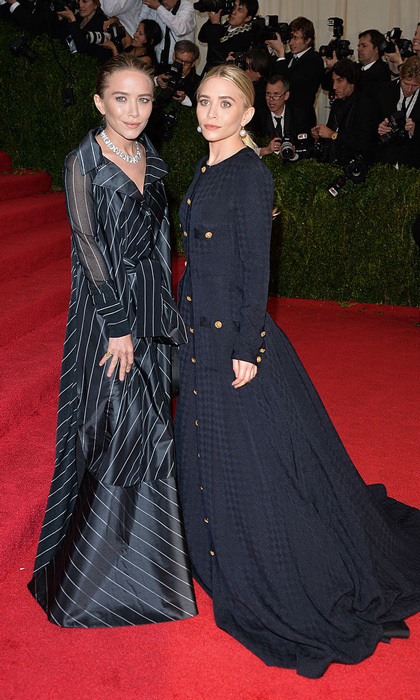 Their dresses may not have been similar in color, but both these dresses were inspired by menswear for the 2014 Met Gala.