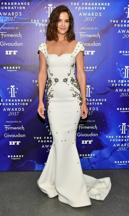 June 14: Katie Holmes was a vision in white donning a mermaid gown by Zac Posen for the 2017 Fragrance Foundation Awards presented by Hearst Magazines in New York City.