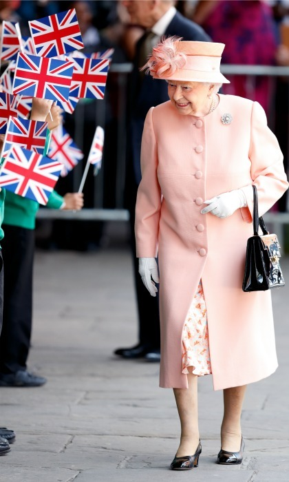 Queen Elizabeth looked just peachy in her uniformed coat, dress and hat, with her signature black shoes, for her arrival to the Slough Railway Station.