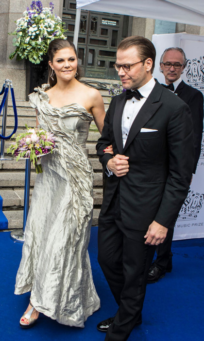 Crown Princess Victoria exuded glamour on the red carpet of the Polar Music Prize ceremony in Stockholm donning a custom one-shoulder silver ruched gown by Swedish designer Diana Orving.