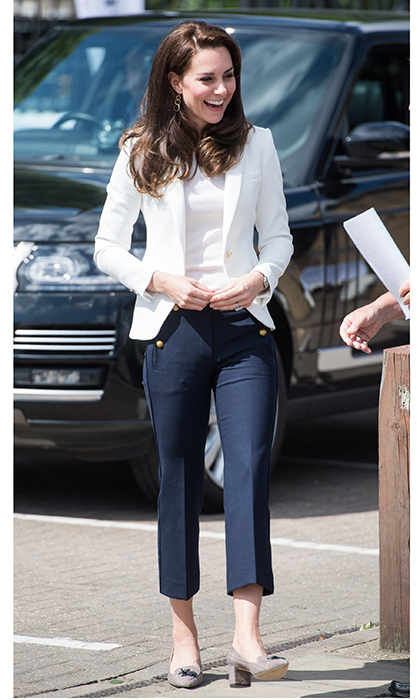 It's not often we see Kate Middleton in tailored pants instead of a skirt! Dressed in a tailored blazer from Zara and cropped navy blue trousers, the Duchess of Cambridge looked fabulous at the 1851 Trust Roadshow in association with Land Rover on London's Isle of Dogs on June 15, 2017. The royal style icon accessorized her nautical-inspired look with a pair of block-heeled J Crew shoes, gold earrings and of course her dazzling sapphire and diamond ring. 